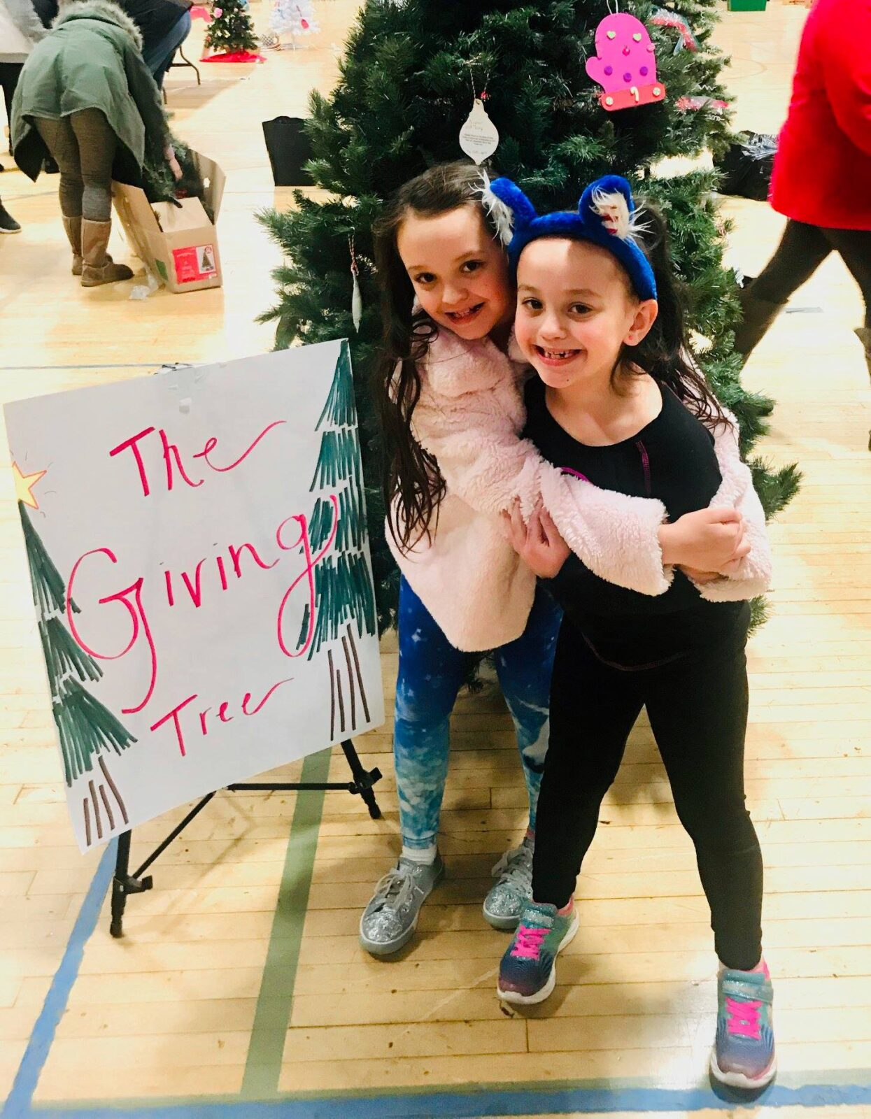 The giving tree girls smiling