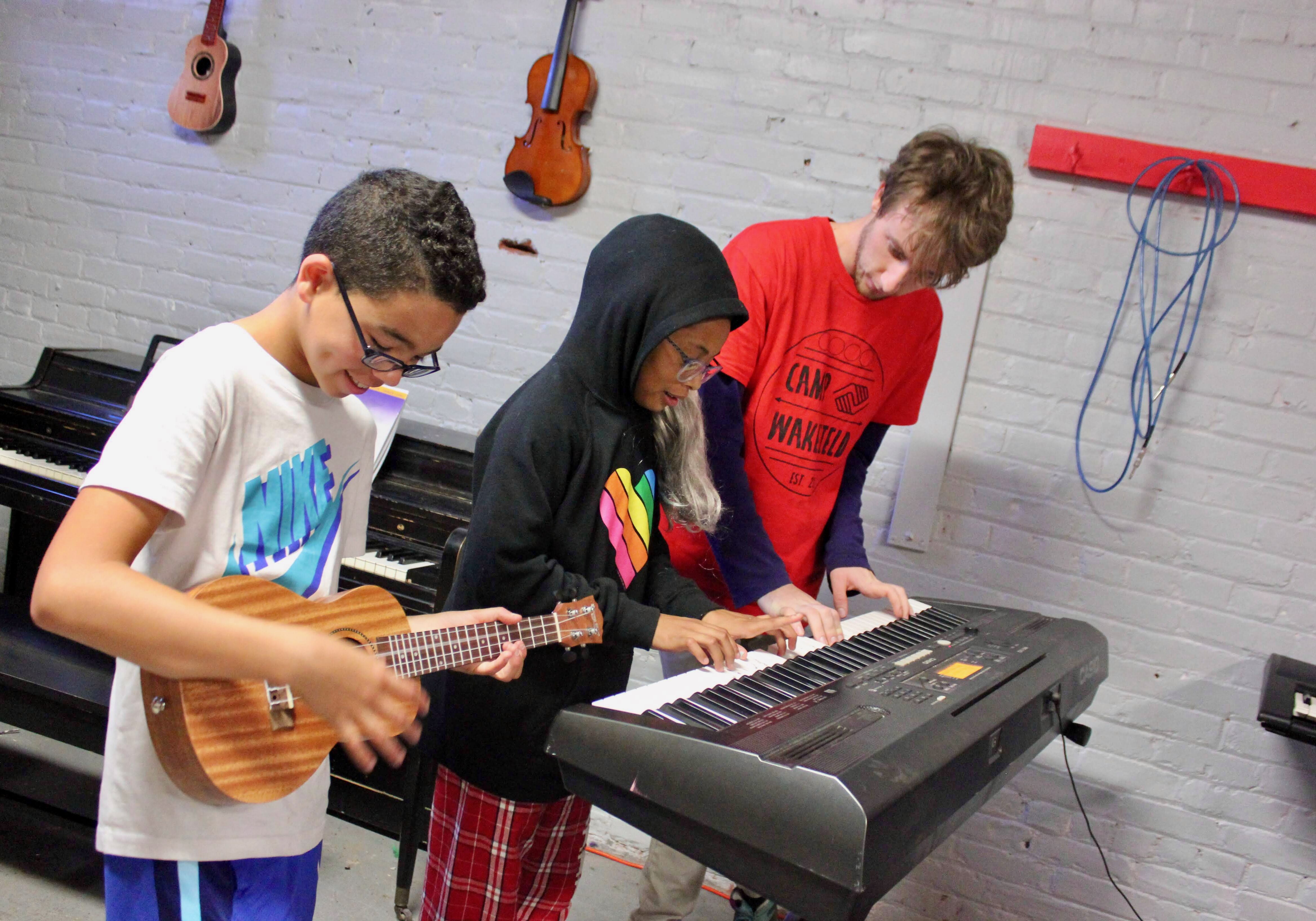 Boys playing music